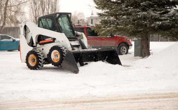Bob cat removing snow in a