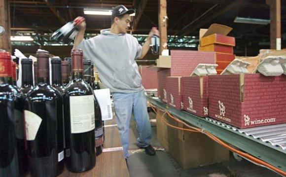Edison Voong packs bottles of