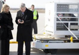 Canadian Prime Minister Harper signs for delivery of pandas