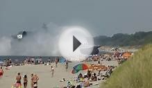 Enormous Russian military ship plows onto crowded beach